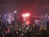 Fireworks in Victoria Harbour on National Day, Hong Kong, China Photographic Print by Ian Trower