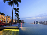 Singapore, Swimmingpool and Singapore Skyline on the 57th Floor of Marina Bay Sands Resort Photographic Print by Michele Falzone