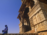 India, Rajasthan, Chittorgarh, a Sari-Clad Woman Leaves a Temple in Chittorgarh Fort Photographic Print by Amar Grover