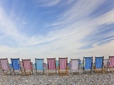 Deckchairs on Pebble Beach, Sidmouth, Devon, Uk Photographic Print by Peter Adams