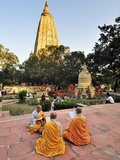 Monks Praying at the Buddhist Mahabodhi Temple, a UNESCO World Heritage Site, in Bodhgaya, India Photographic Print by Mauricio Abreu