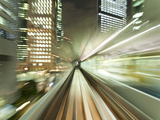 Asia, Japan, Honshu, Tokyo, Pov Blurred Motion of Tokyo Buildings from a Moving Train Photographic Print by Gavin Hellier