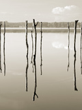 """Suspended in the Air"" – Reflected in Water Remains of the Old Jetty on the Photographie par Nadia Isakova"