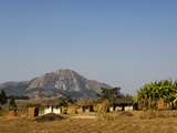 Malawi, Dedza, Grass-Roofed Houses in a Rural Village in the Dedza Region Fotografisk tryk af John Warburton-lee