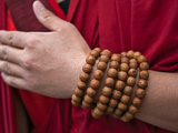 Prayer Beads Wrapped Round the Wrist of a Red-Robed Monk Near Mongar, Special Religious Significanc Photographic Print by Nigel Pavitt