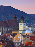 The Black Church and Town Hall Clock Tower Illuminated at Dawn, Piata Sfatului, Brasov, Transylvani Photographic Print by Doug Pearson