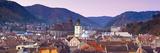 The Black Church and Town Hall Clock Tower Illuminated at Dawn, Piata Sfatului, Brasov, Transylvani Photographic Print by Doug Pearson