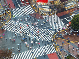 Asia, Japan, Tokyo, Shibuya, Shibuya Crossing - Crowds of People Crossing the Famous Intersection a Photographic Print by Gavin Hellier