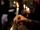 Sicily, Italy, Western Europe, a Believer, Holding a Candle During the Easter Eve Ceremony at the T Fotografisk tryk af Ken Scicluna