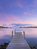 Norway, Oslo, Oslo Fjord, Jetty over Lake at Dusk Photographic Print by Shaun Egan