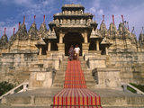 India, Rajasthan, Ranakpur, a Couple Descend Steps at the Famous Chaumukha Mandir, an Elaborately S Photographic Print by Amar Grover