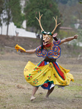A Dancer Performs Shazam Tam, Dance of Four Stags Outside Punakha Dzong, Dance Commemorates the Sub Photographic Print by Nigel Pavitt
