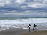 Surfers on Grande Plage Beach, Biarritz, Aquitaine, France Photographic Print by Nadia Isakova