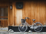 Japan, Chubu Region, Kyoto, Gion, a Bicycle Rests Against the Wall of a Traditional Building Photographic Print by Nick Ledger
