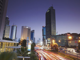 Traffic Moving Along Jalan Thamsin at Dusk, Jakarta, Java, Indonesia Photographic Print by Ian Trower