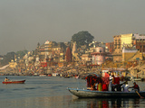 India, Uttar Pradesh, Varanasi (Aka Benares), Small Boats, Popular Among Tourists at Dawn and Sunse Photographic Print by Amar Grover