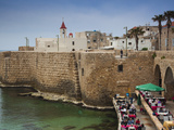Israel, North Coast, Akko-Acre, Ancient City, Waterfront Cafe in City Walls Photographic Print by Walter Bibikow