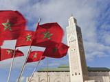 Flags of Morocco Waving in the Wind and Hassan Ii Mosque, the Third Largest Mosque in the World, Ca Photographic Print by Gavin Hellier