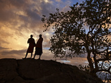 Two Maasai Men Silhouetted on a Hill at Sunset Photographic Print by Nigel Pavitt