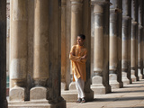 A Student Relaxes Beside the Pillars of the Impressive Hugli Imambara Building Which Was Built in 1 Photographic Print by Nigel Pavitt