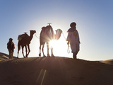 Tuareg Man with Camel Train, Erg Chebbi, Sahara Desert, Morocco Photographic Print by Peter Adams