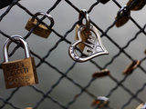 Locks on the Bridges of Paris are Quite Popular for Couples to Manifest their Wish for Eternal Love Lámina fotográfica por David Bank