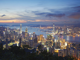 Hong Kong Island and Kowloon Skylines at Sunset, Hong Kong, China Photographic Print by Ian Trower