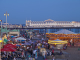 United Kingdom, England, Carousels on Brighton Beachfront at Twilight Photographic Print by Jane Sweeney