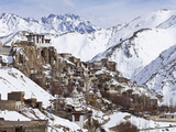 India, Ladakh, Lamayuru, Lamayuru Monastery, Remote and Isolated, Hemmed in by Dramatic Snow Covere Photographic Print by Katie Garrod