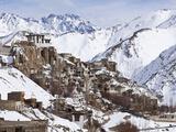 India, Ladakh, Lamayuru, Lamayuru Monastery, Remote and Isolated, Hemmed in by Dramatic Snow Covere Photographic Print by Katie Garrod