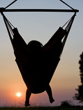 Malawi, Lake Malawi National Park, Young Guest Relaxes in a Hammock at Pumulani Lodge, (MR) Photographic Print by John Warburton-lee