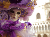 Venice, Veneto, Italy, a Masked Character in Front of the &#39;Palazzo Dei Dogi&#39; During Carnival Photographic Print by Ken Scicluna