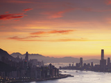 Hong Kong Island and Tsim Sha Tsui Skylines at Sunset, Hong Kong, China Photographic Print by Ian Trower