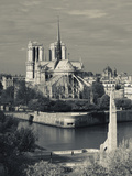France, Paris,Cathedrale Notre Dame and the Pont De La Tournelle Bridge Photographic Print by Walter Bibikow