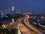City Skyline and Highway, Kuala Lumpur, Malaysia Photographic Print by Jon Arnold