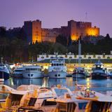 Palace of the Grand Masters and Mandraki Harbour Illuminated at Dusk, Rhodes Town, Rhodes, Greece Photographic Print by Doug Pearson