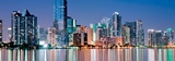 Shimmering Skyline of Miami along Biscayne Bay on Cloudness Night Prints