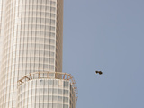 Trash Floating Past the Burj in Dubai, the World's Tallest Building Photographic Print by Ashley Cooper