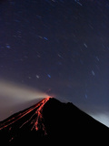 Star Trails over the Erupting Arenal Volcano, Costa Rica Photographic Print by Gregory Basco