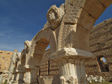 Arches and Gorgon Heads in the Severan Forum, Leptis Magna Roman Ruins, Libya Photographic Print by Gary Cook