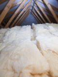 Insulation in a House Loft or Roof Space to Reduce Heat Loss and Gain Photographic Print by Ashley Cooper