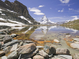 The Matterhorn Reflected in a Mountain Lake Above Zermatt, Switzerland Photographic Print by Ashley Cooper