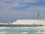 Tourists in the Surf Near a Project to Create New Land Photographic Print by Ashley Cooper