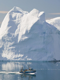 Fishing Boat Sails Through Icebergs Photographic Print by Ashley Cooper