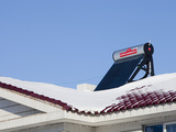 Solar Water Heater on the Roof of a Chinese Building Photographic Print by Ashley Cooper