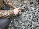 A Man Breaks Up Coal for Domestic Use, China Photographic Print by Ashley Cooper