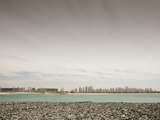 The Dubai Skyline from the Palm Resort Area Photographic Print by Ashley Cooper