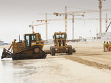 Workers Creating a New Beach Resort on Former Sea Bed Land in Dubai Photographic Print by Ashley Cooper