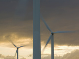 Wind Turbines Spinning Photographic Print by Ashley Cooper