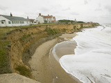 Crashing Waves and Stormy Seas Destroying Coastal Defenses Photographic Print by Ashley Cooper